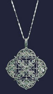 Dainty and pretty platinum and diamond pendent, once housed nine post set (probably pearls) stones.