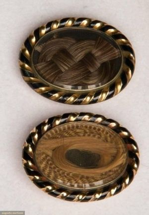 Mourning hair brooches 1850's  these are weird, but also very intriguing- kind of like how horse owners keep braids of the tail hair when their horse passes.