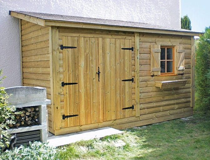 Installer un appentis en panneaux pr fabriqu s pour le - Fabriquer un abris de jardin en bois ...
