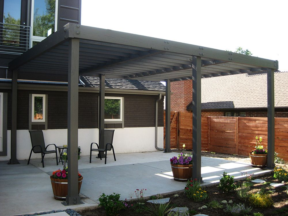 Modern Pergola Attached To House Using Solid Wood With Black Painted For  Patio Complete With Iron Patio Chairs Decorated With Ornamental Flowers In  The ...