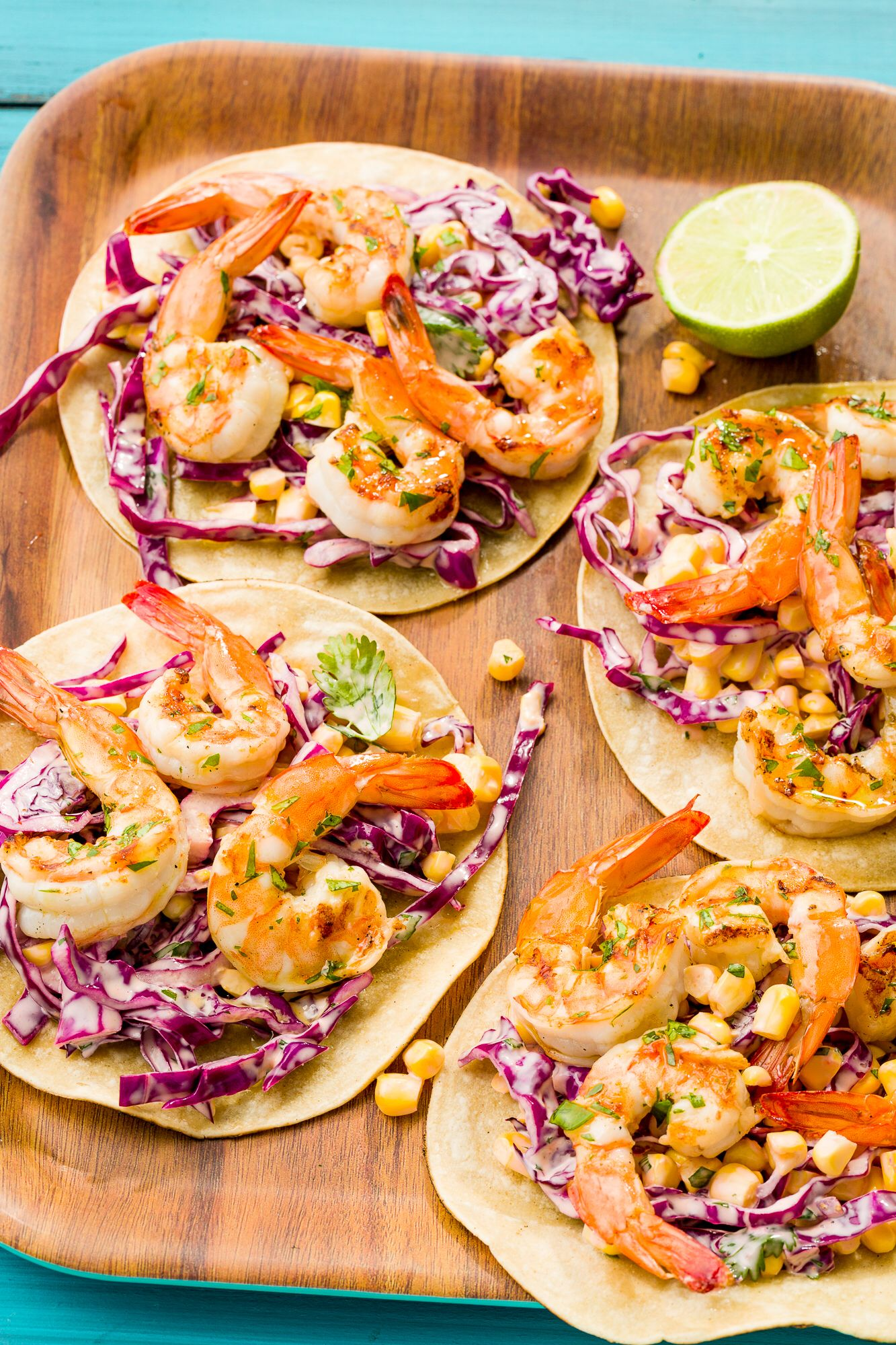 Grilled Shrimp Tacos with Sriracha Slaw  Smoky, grilled shrimp and spicy slaw are the keys to next-level tacos.  Get the recipe from Delish.