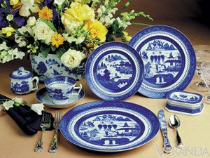 From an ancient Chinese trading port to modern-day table settings, this traditional nineteenth-century design, blue and white Canton ware was produced over a hundred-year period.  Blue Canton from Mottahedeh, 210 for 5-piece place setting.