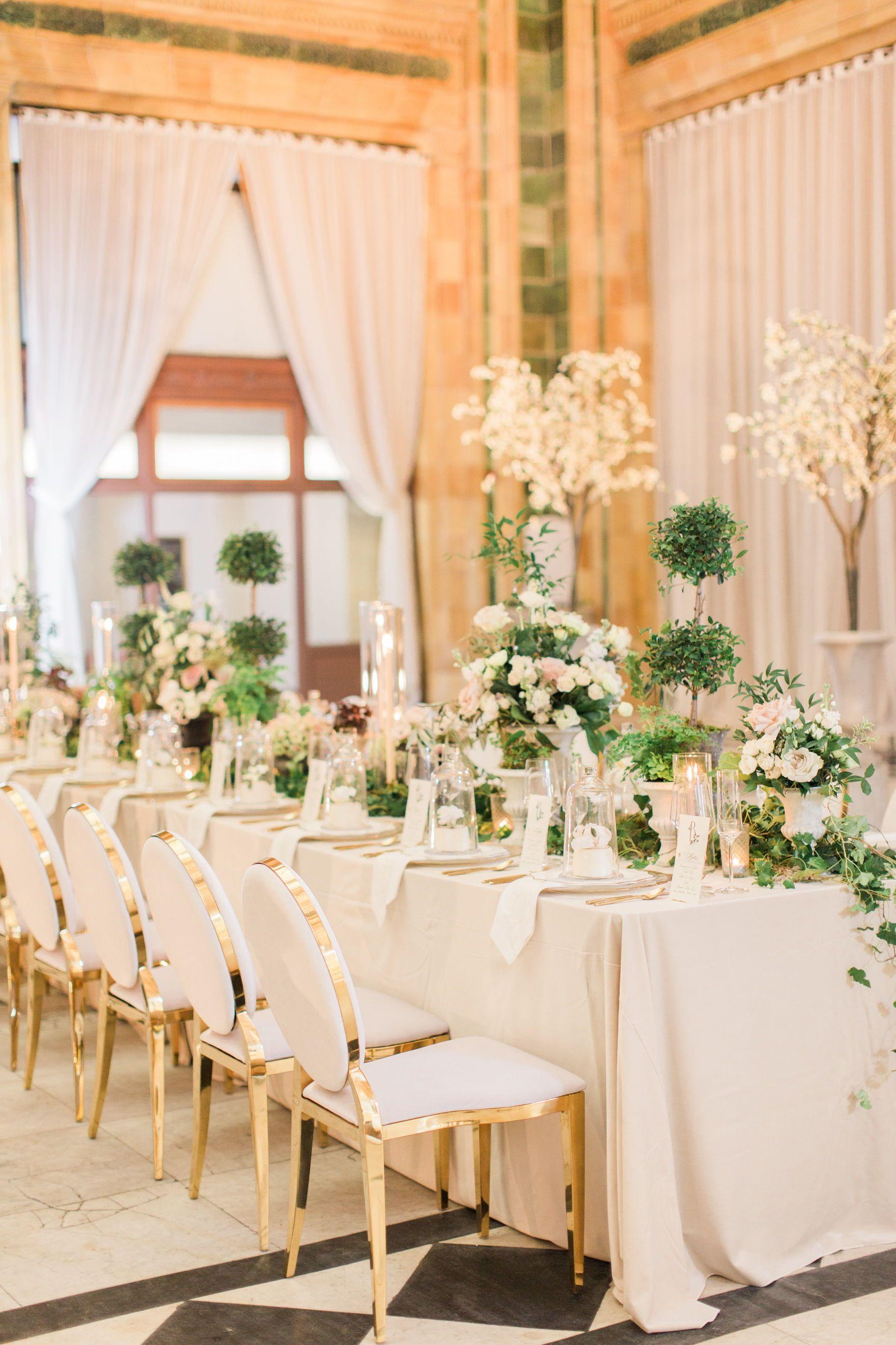 A big and beautiful ballroom wedding with tons of greenery ...