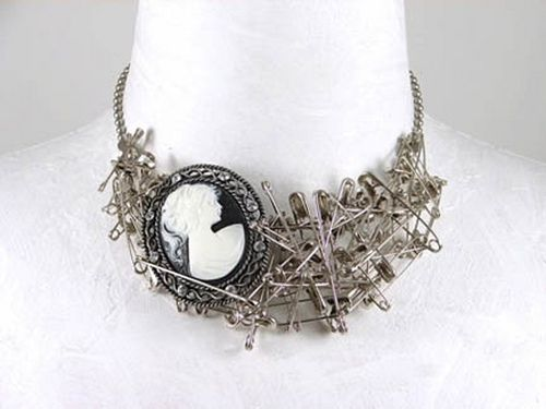 A cameo & safety pin necklace from Realm Jewelry
