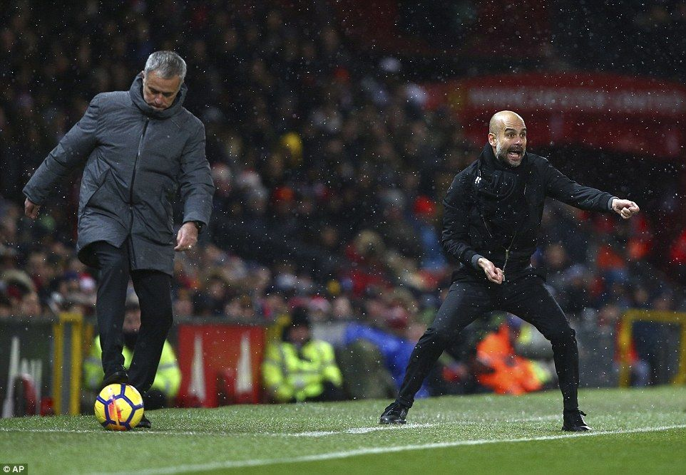 Guardiola gesticulates on from his technical area while