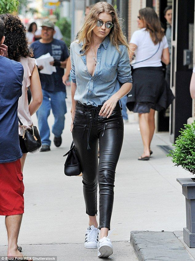 Gigi Hadid heats up NYC in unbuttoned denim shirt and leather trousers