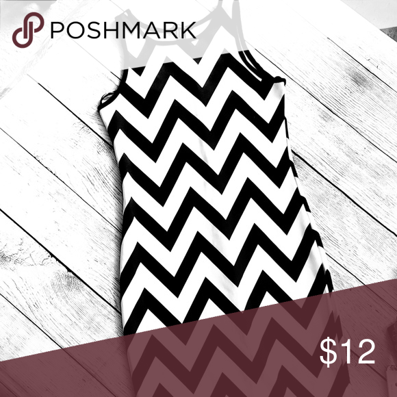 3/ $20 Black and white sleeveless dress 3/$20 NWOT- BLACK AND WHITE ZIGZAG MIDI DRESS SIZE MEDIUM 6 94% POLYESTER Arm pit to armpit 14.5 inches, most narrow is 13 inches and from top of shoulder to hem it is 39.5 inches Forever 21 Dresses Midi #blacksleevelessdress