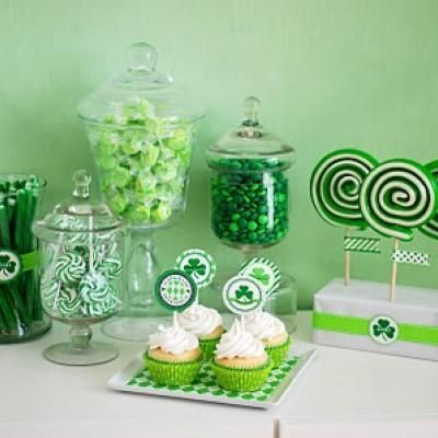 St. Patrick's Day Party Dessert Bar {diy decor}  I adore this green candy bar!  It's decorated with green M&M's, lolli pops, cupcakes, mints, taffy, and candy sticks.  Completely darling