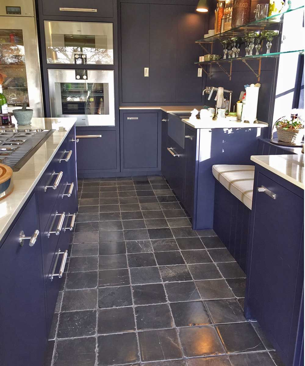 Historic blue limestone 20x20cm tiles were used for the