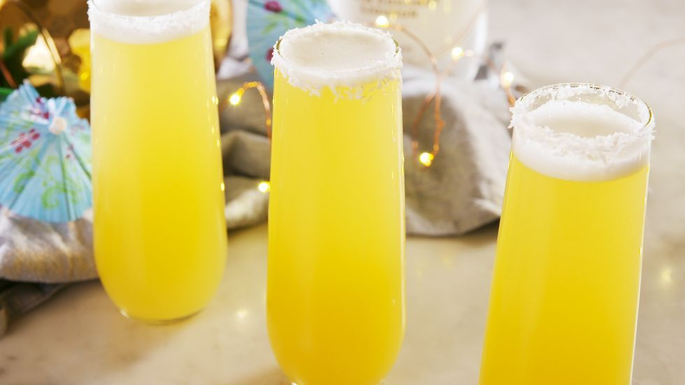 Give Brunch A Tropical Twist With Mimosa Coladas Recipe In 2020 Tropical Cocktail Recipes Mimosa Brunch