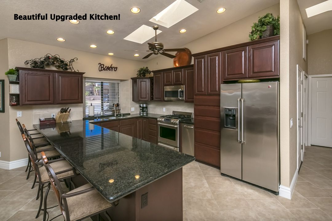 Amazing Kitchen with granite counter tops, stainless steel appliances, cherry cabinets