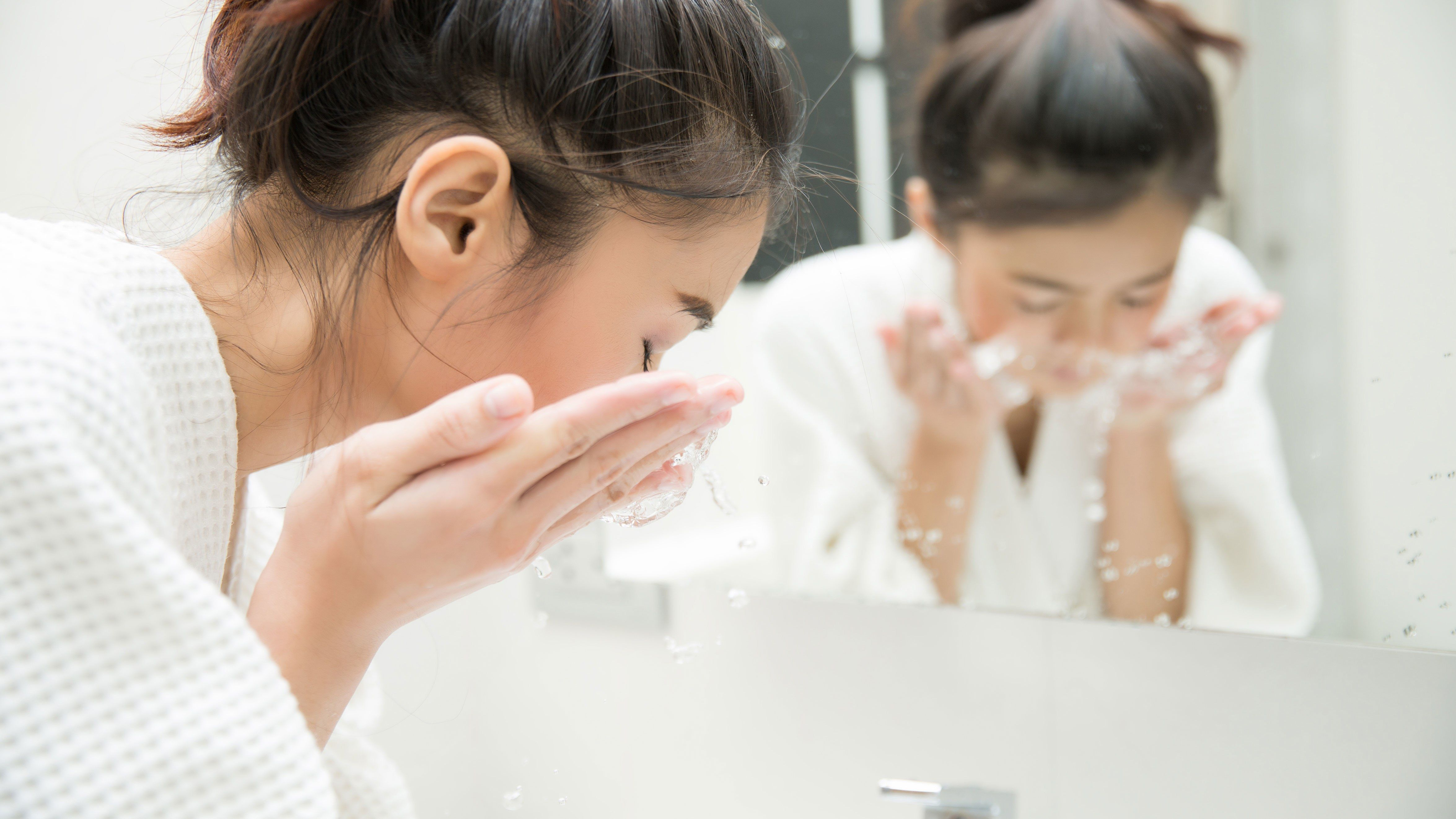 Image result for washing face in mirror