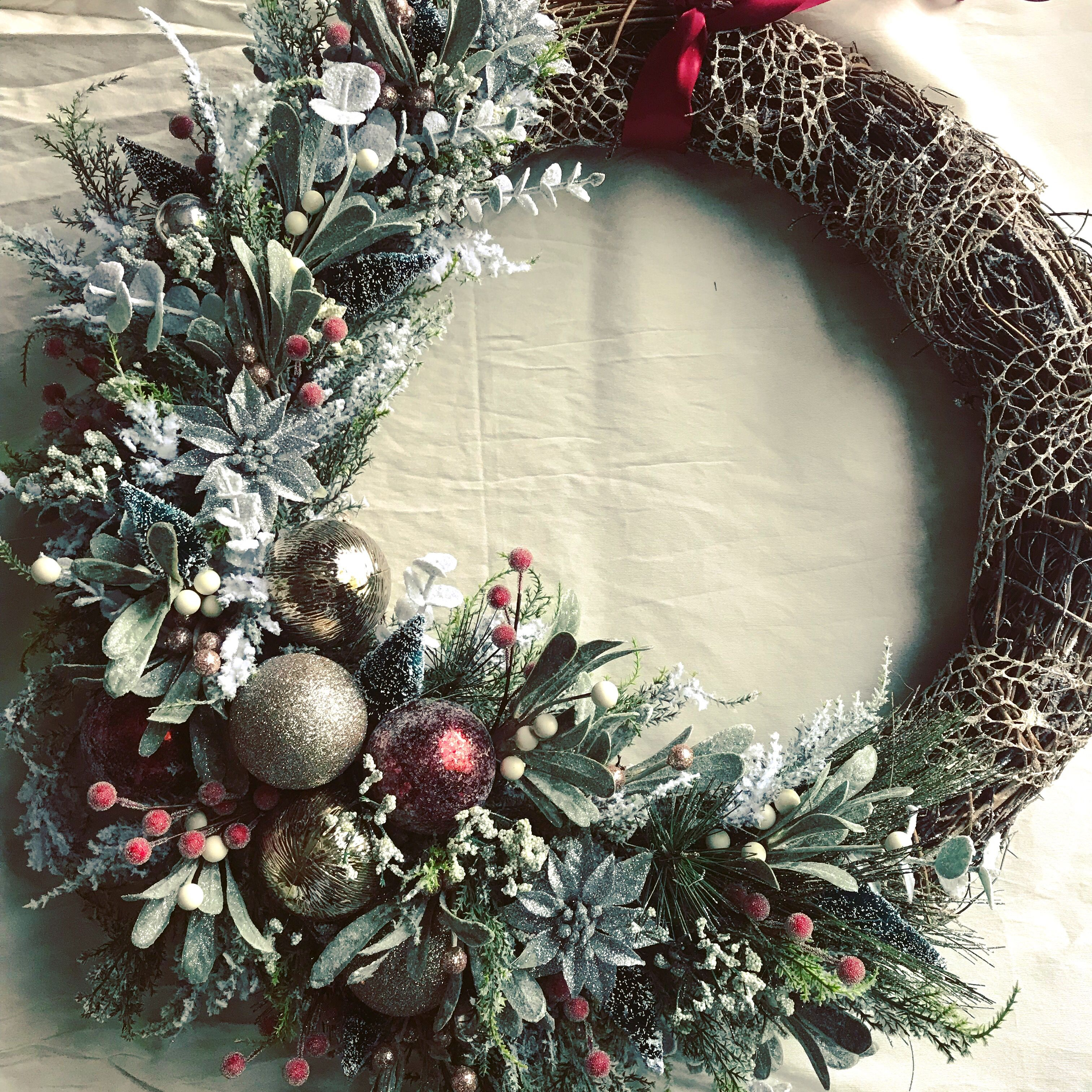 Beautiful frosted wreath I finished today Grapevine wreath