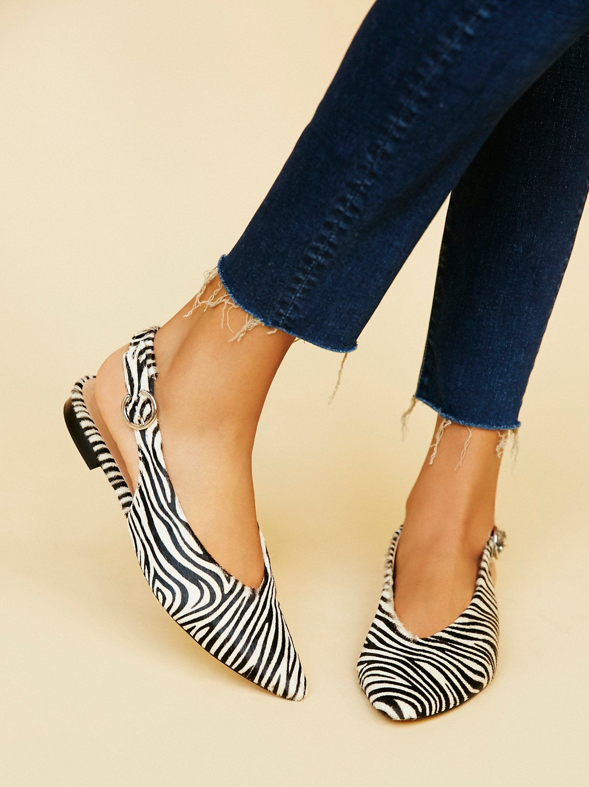 40f9789ebc3b Zebra printed calf-hair pointed toe flats with an adjustable buckle in back  and elastic band for easy wear. Padded footbed for a more comfortable fit.
