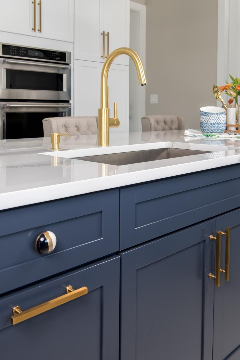 Curved Faucet In Blue Kitchen Island With Quartz Countertop With