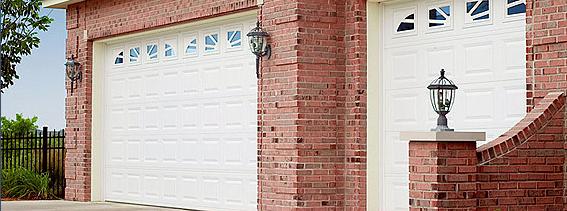 White Double Car Garage And Single Car Garage With 4 Piece Sunburst And Insulated Windows Garage Door Styles Garage Doors Doors
