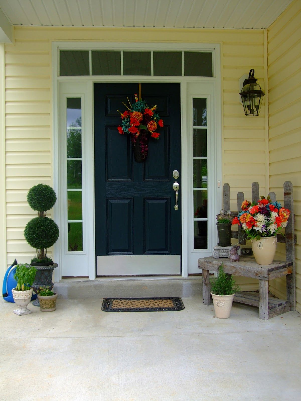 Provide a properties outer a moment and simple for Front door yellow paint