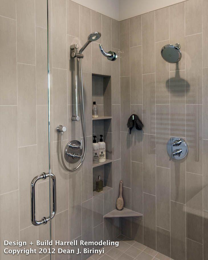 Dual shower heads create a spa-like experience as the warm water ...