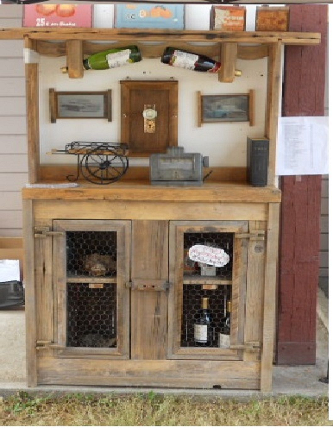 wine hutch with wooden hinges and latch. Chicken wire doors. Made from an old schoolhouse steps from 1931