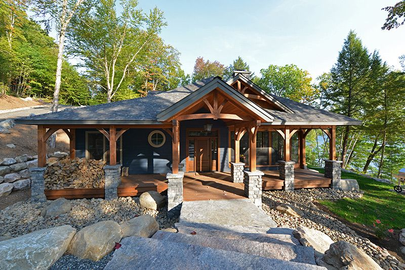 This Cabin Styled Timber Frame Is Ideal For A Weekend Getaway The 2128 Sq Ft Single Story Floor Plan Featur Timber Frame Porch Timber Framing Cottage Exterior