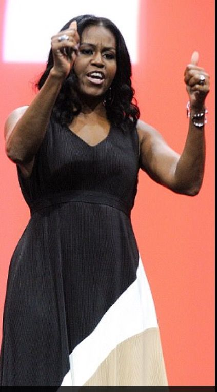 After a leisurely three month vacation, Michelle Obama has made her #First public appearance since the #inauguration.. Just days after her husband made a speak at Chicago University Michelle Obama wore a long black, white beige dress to show of her toned arms for the event. Former #FirstLady #MichelleObama was the keynote speaker at the Orange County Convention Center at the 2017 Conference on Architecture organized by the American Institute of Architects on Thursday April 27, 2017