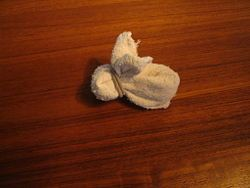 Fold a Rabbit Wash Cloth (holds an egg perfectly, so they are cute as a party favor or gift for Easter)