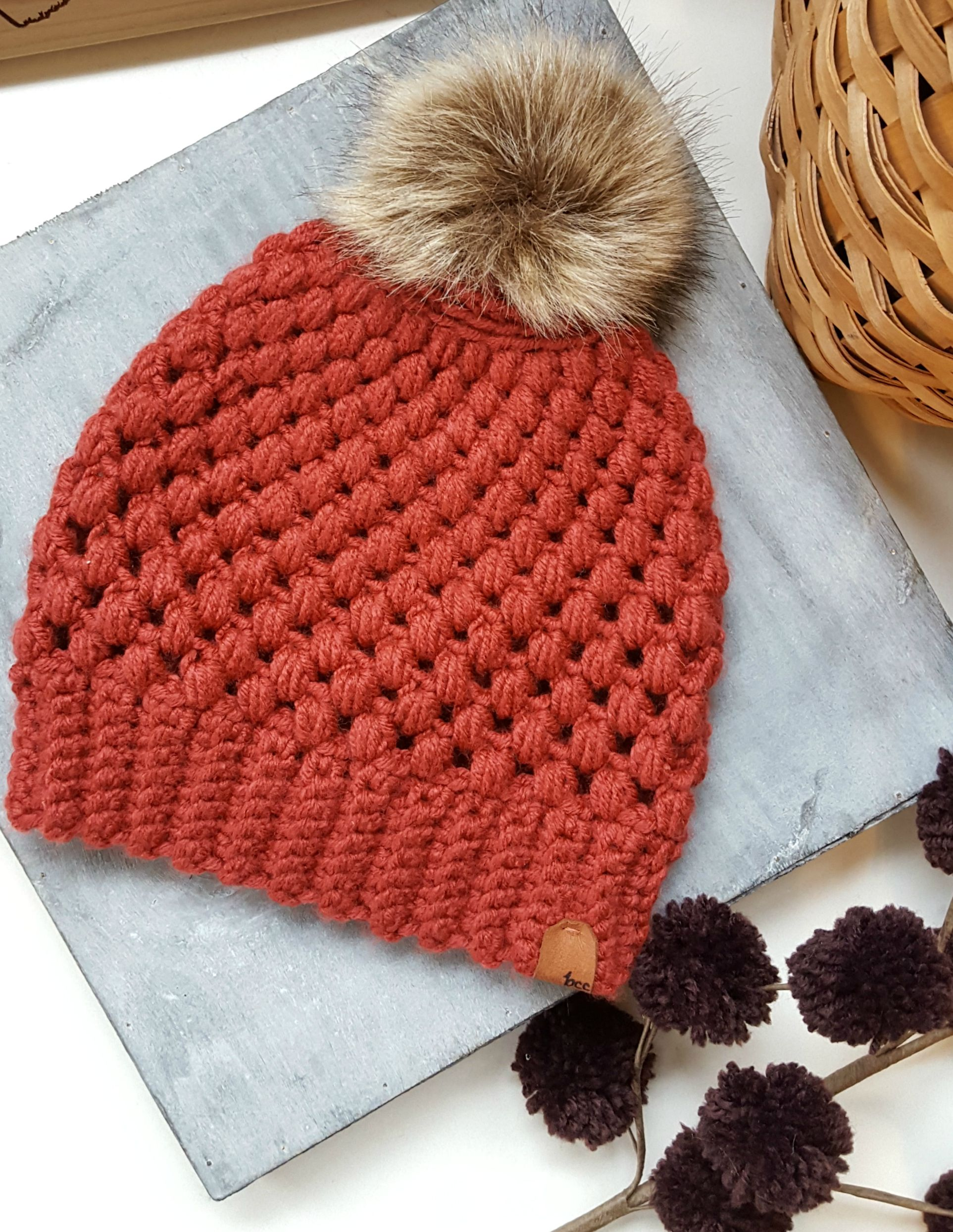 ad8ff22b10e The PUFF AND POM BEANIE by Bella s Custom Crochets This on-trend puffy faux  fur pom pom slouchy beanie is the perfect cozy addition to your winter  wardrobe!