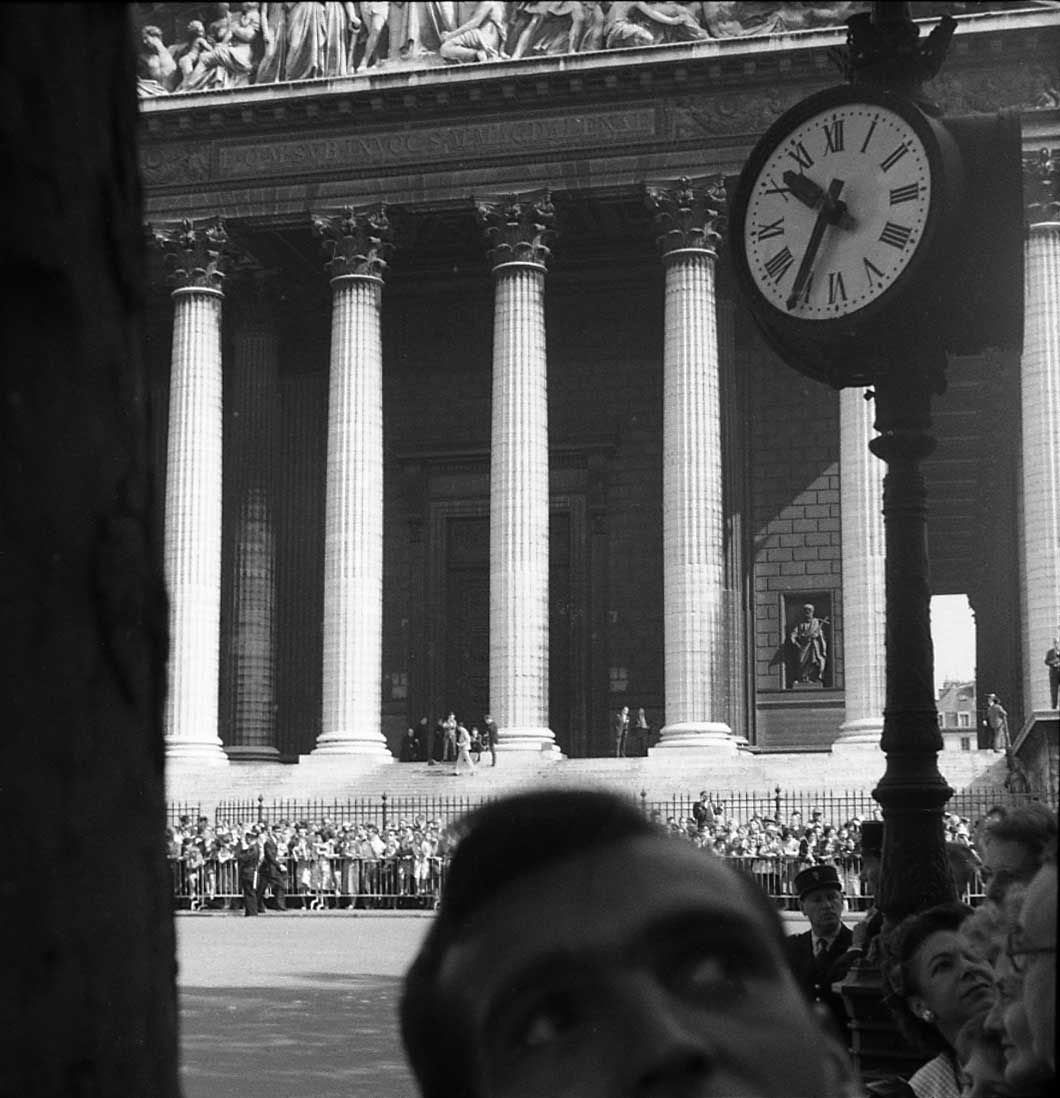 VIVIAN MAIERParis, France (Église de St. Marie La Madeleine; Man and Clock), c.1959 For more information contact: The Jeffrey Goldstein Collectionwww.vivianmaierphotography.com