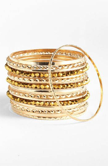 Textured gold fine bangles for an ethnic look