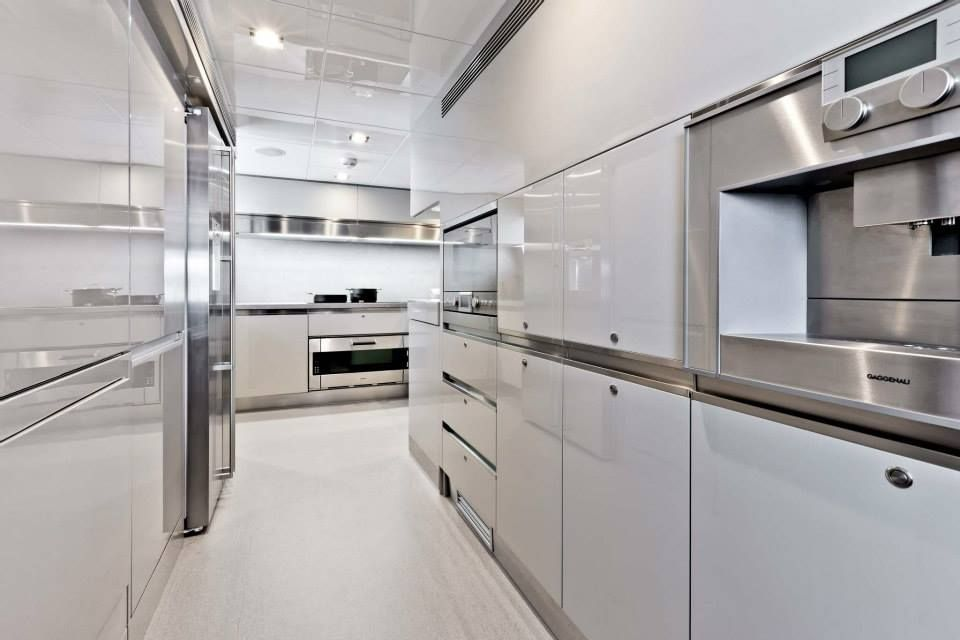 """The Custom Line 100' debuted in Cannes in September 2011, winning the """"Best Layout"""" award. This model won another award: """"Motor #Boat of the Year 2012"""" in London.  Photo: Archivio Ferretti Custom Line  #marine #interiordesign #kitchen"""