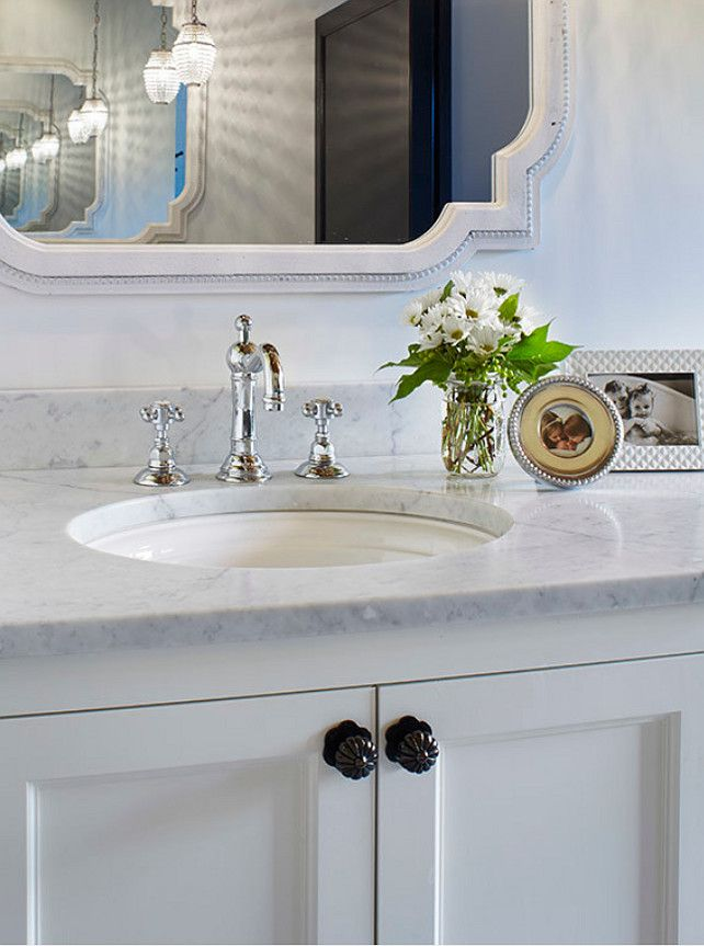White Bathroom Vanity With Carrara Marble Countertop And The