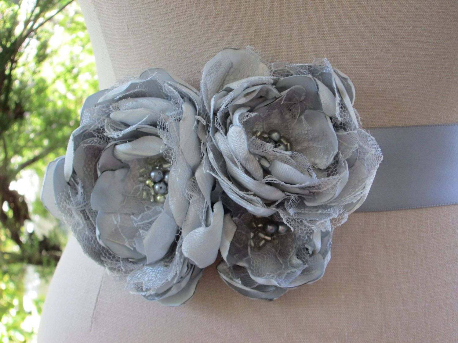 Silver gray fabric flower belt ribbon sash for wedding, special occasion. $40.00, via Etsy.