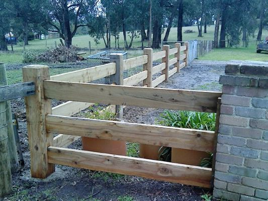 Rural timber post and rail formal entrance fencing front
