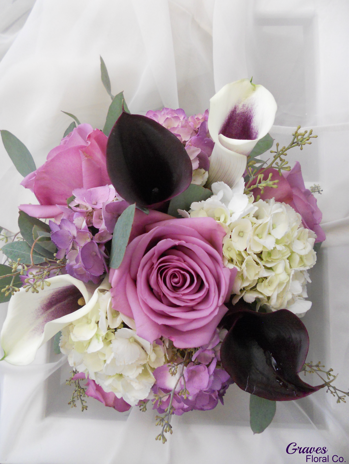 cool water roses and eggplant calla lily Wedding flowers