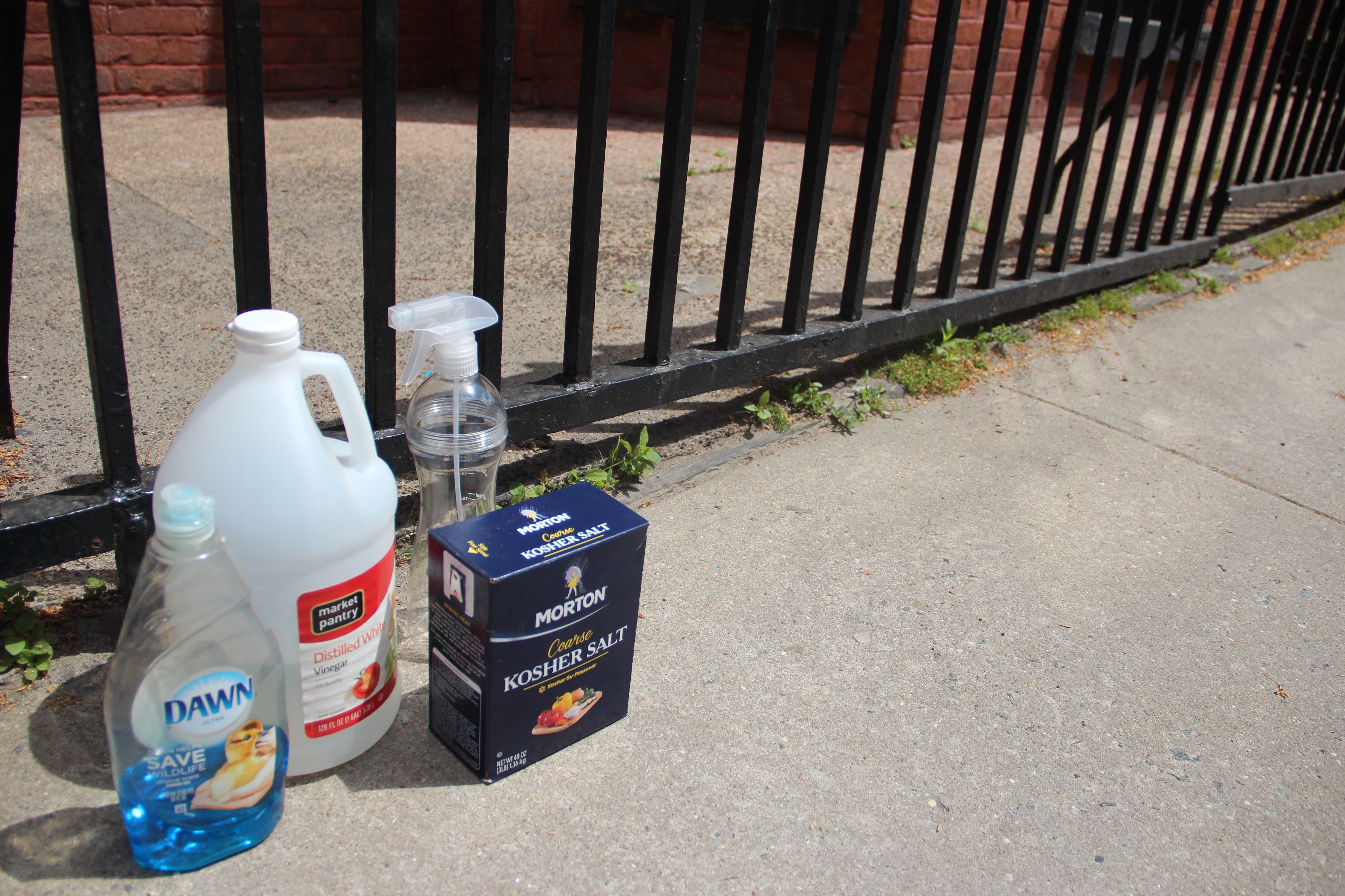 how to get rid of oil stains on pavement