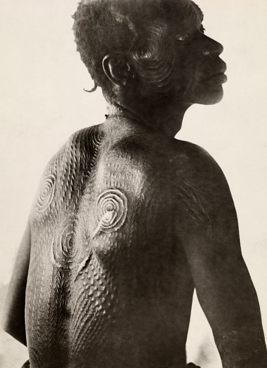 A man shows tribal scars on his back in the Democratic Republic of the Congo, November 1919.Photograph by E. Torday, National Geographic