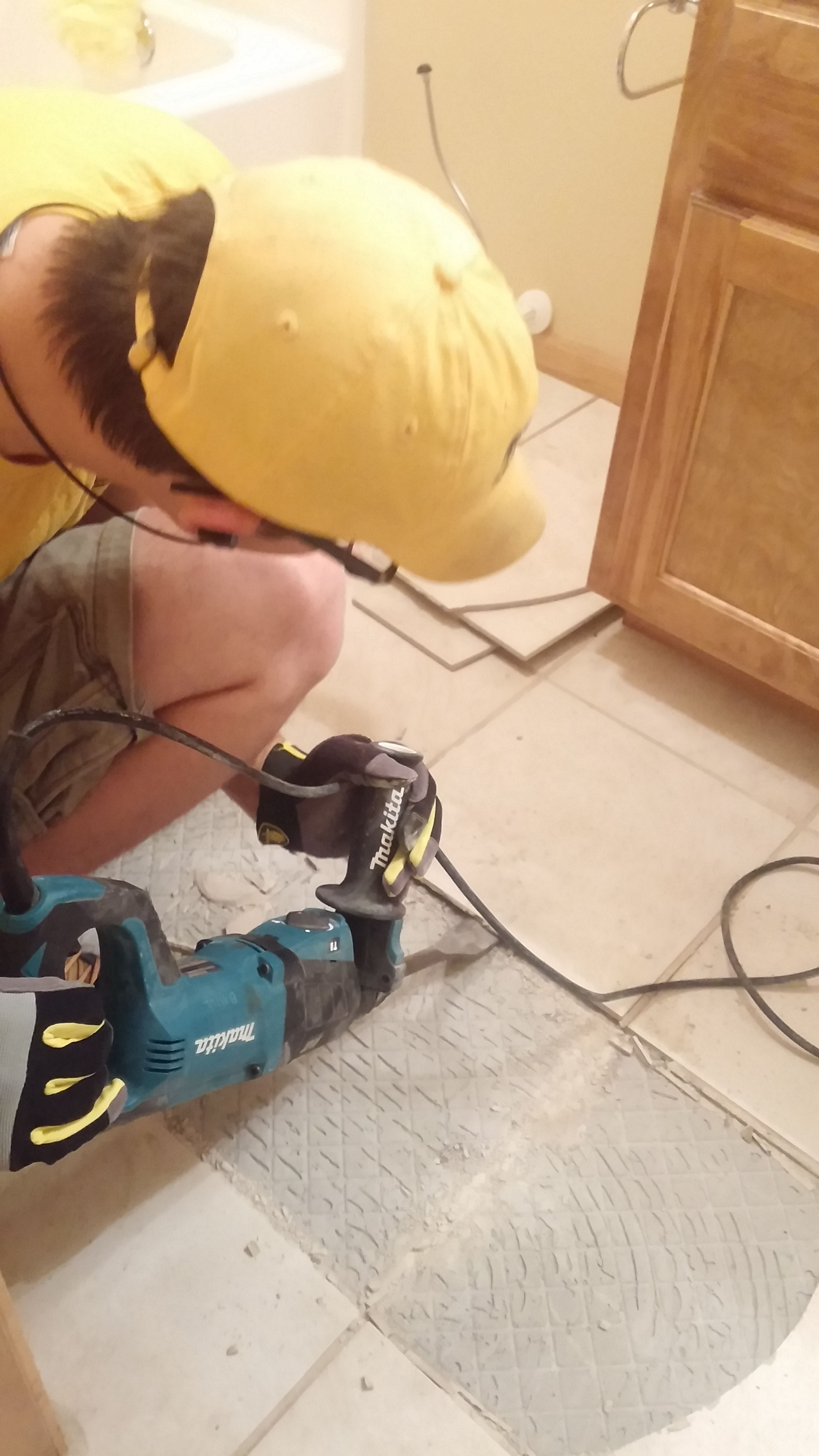 The Best Tool For Tile Removal Is A Rotary Hammer With Flat Chisel Bit