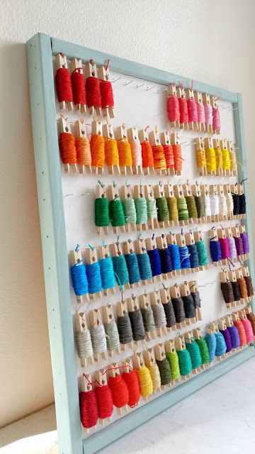 An embroidery floss organizer is a great way to keep your skeins organized and they look so pretty on the clothespins! #embroidery