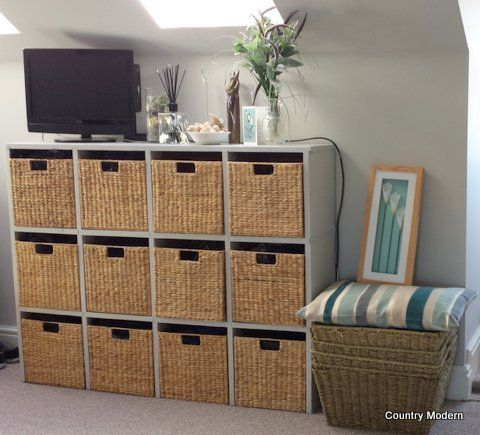 Here is a great example of too much similarity easily becoming too boring. Change it up by using 2 sets of similar colored containers and add some more visual interest by leaving a row of open cubbies with visible storage of some stylish items you can put away while on display.