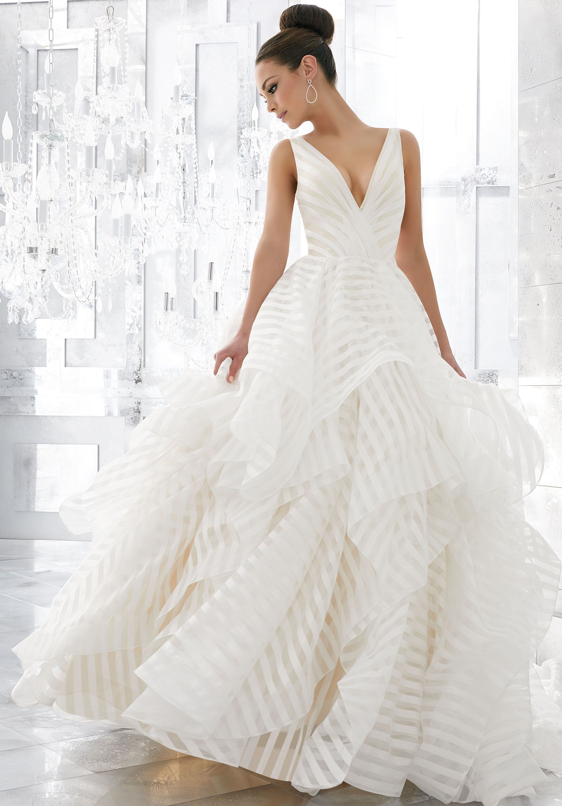 aaaa85dcbb0 Horsehair edging - folds of organza in this gown s sublime full skirt give  shape to clouds of billowing flounces fantasy bride- wedding ball gown