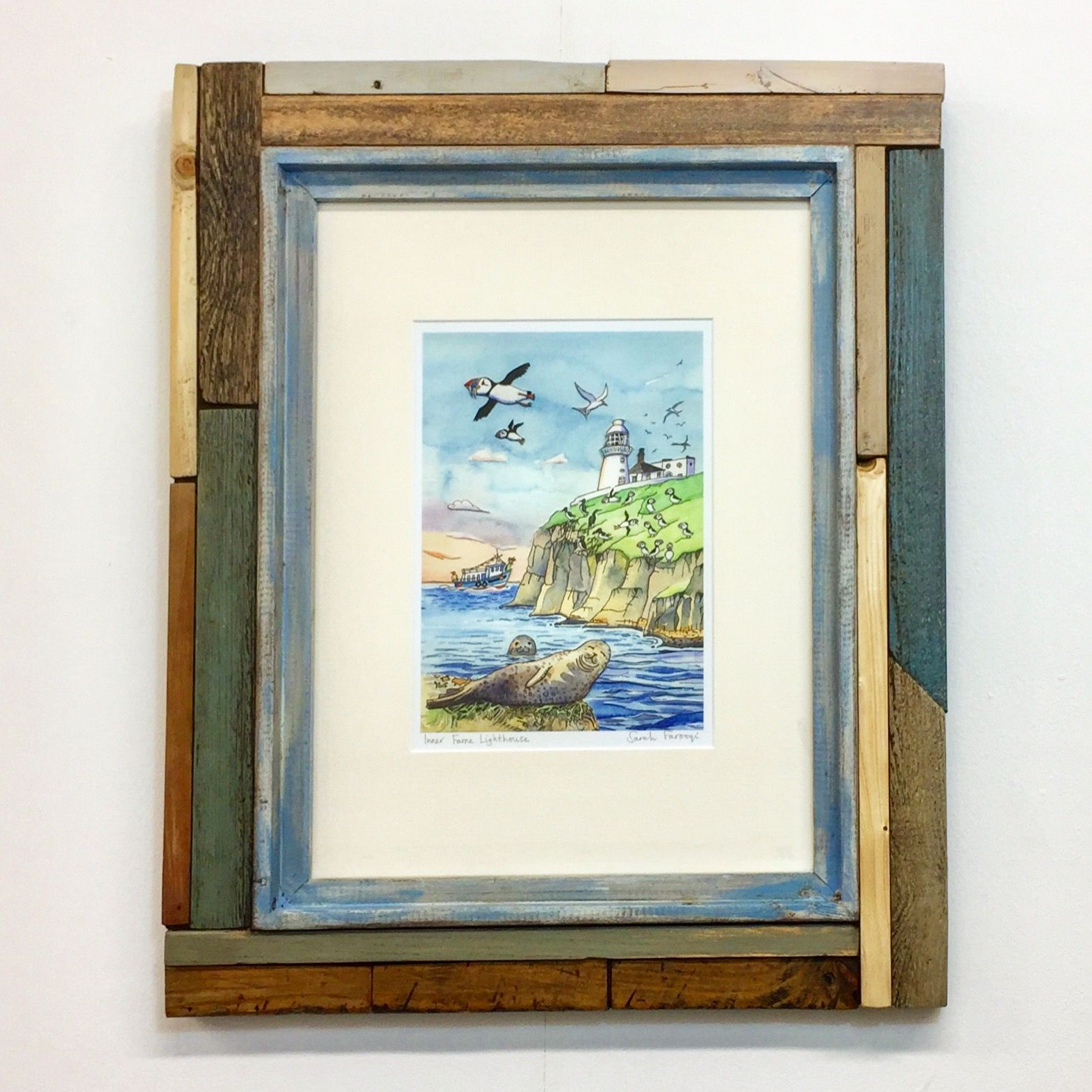 Puffins! I love puffins. I love the word puffins as well. Giclee print by Sarah Farooqi and reclaimed wood frame by me. The latter includes pieces from an artist's easel.