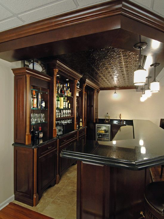 The best home bar ever! I love the dark wood and the metal ceiling