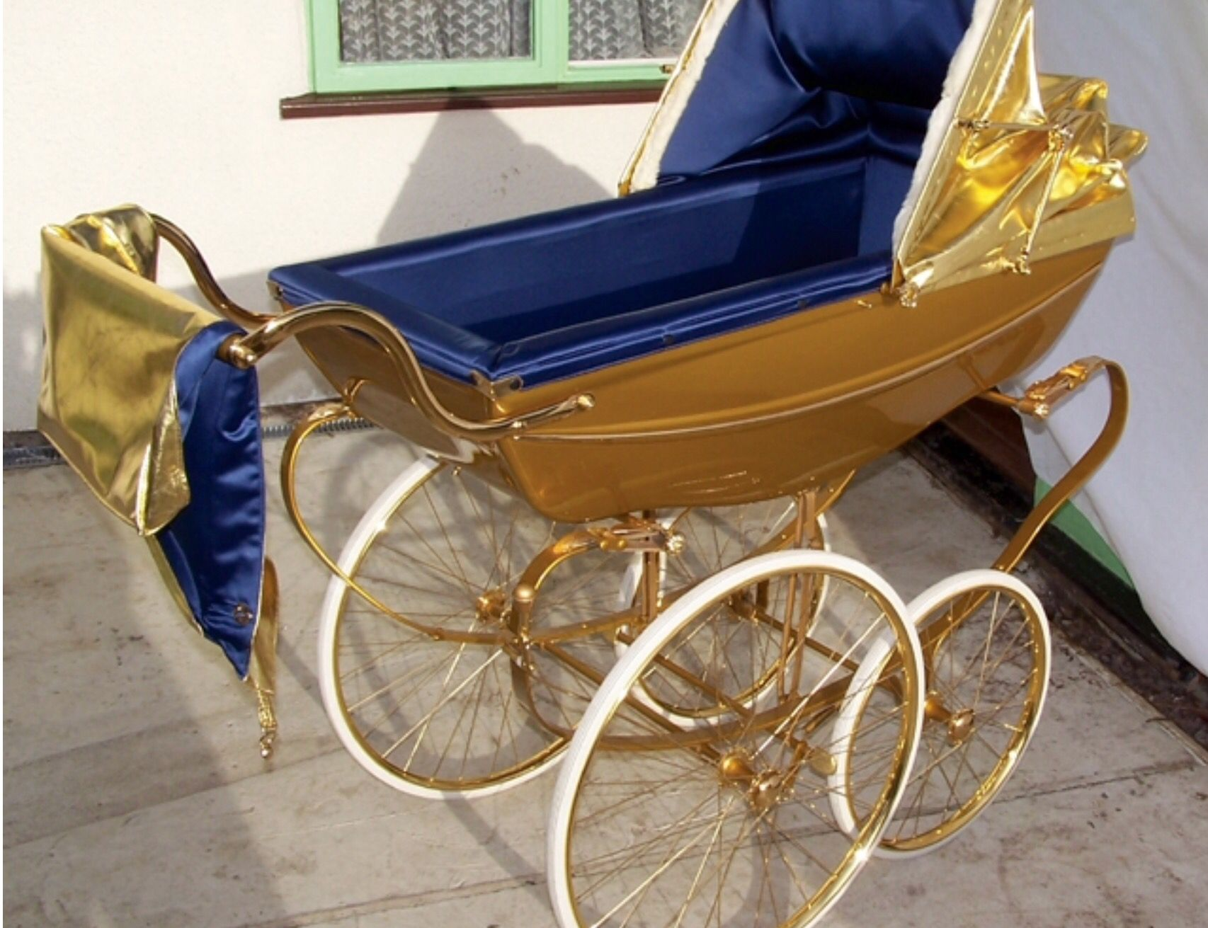 Royal blue and gold Coach built pram Expensive baby gifts