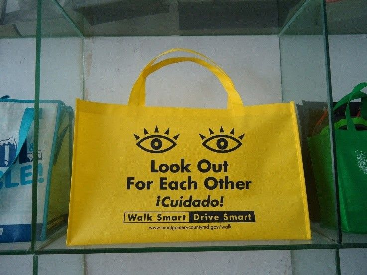 yellow bag with safety message to look out for each other on it