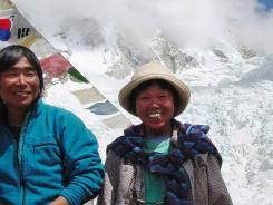 Tamae Watanabe, age 73, poses with photograher Noriyuki Muraguchi at a base camp on the foot of Mt. Everest in Nepal.  She climbed to Everest's peak Saturday, smashing her own record to again become the oldest woman to scale the world's highest mountain.