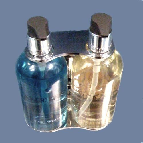 A Wall Mounted Liquid Soaps Bottle Holder Which Is Great