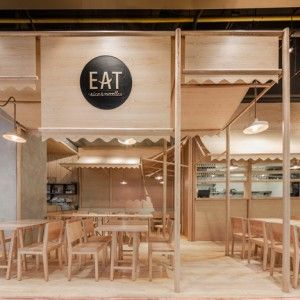 Onion uses solid ash and plywood to create a monochrome restaurant interior in Bangkok