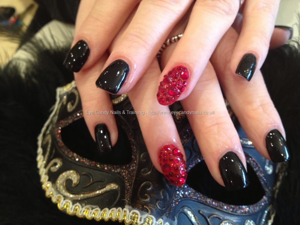 black polish with red swarovski crystal ring fingers over acrylic