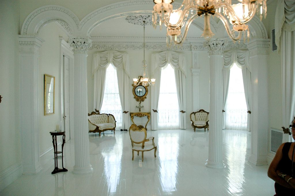 """White Ballroom  Nottaway Plantation-5375 Nottaway Plantation-5524 Nottaway Plantation, located near the town of White Castle, Louisiana, on the banks of the Mississippi river is the probably the largest plantation manor home still standing today. It is one of the most unique and beautiful of all the old plantation homes. Nottaway was built in 1859 for wealthy sugar tycoon John Hampden Randolph and his wife and it was home to their eleven children. The """"White Castle"""" as it is often referred…"""