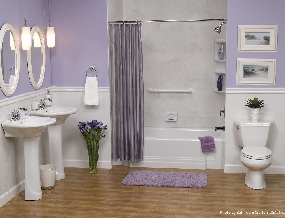Light purple linens pair well with a white alcove bathtub for Bathroom ideas violet